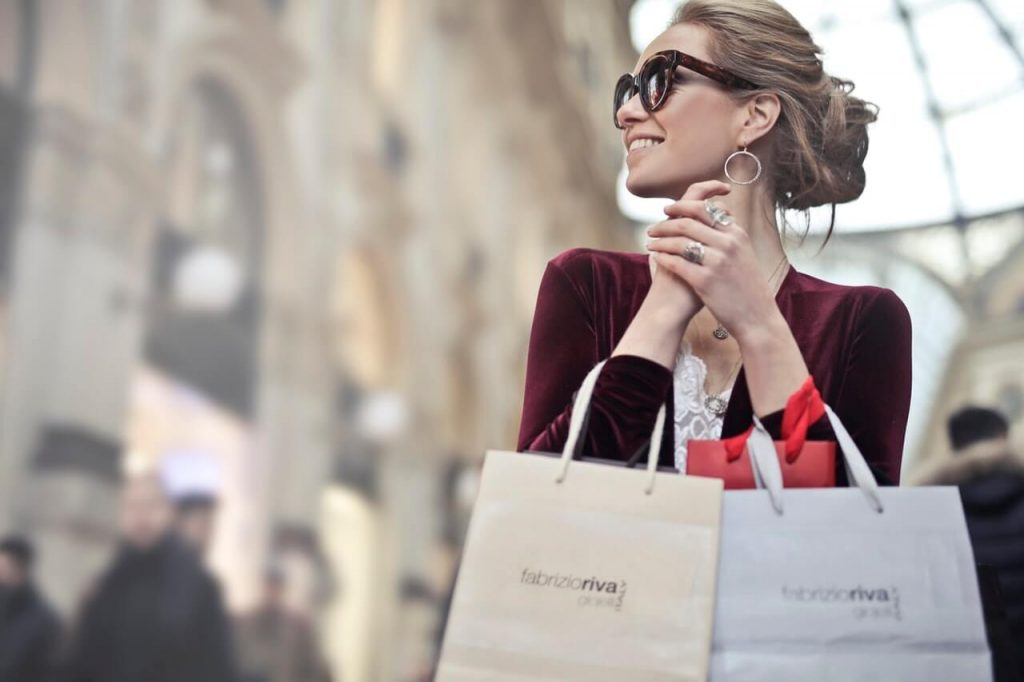 Brunette woman holding shopping bags